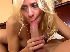 Hot and horny mature blonde woman Payton Leigh sucks and strokes big stiff penis very well bringing a lot of man to the dude. She rides up his dong fe