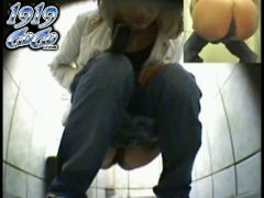 Dazzling and sexy solo girl is ing in the public toilet