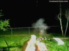 two girls shots fireworks with her asses