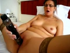 Mature babe masturbating with toys