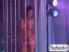 Party girls strip and teasing in a club