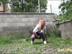 Blonde caught pissing in the weeds