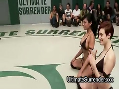 Two female teams naked wrestling in front of crowd