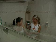 Lesbo gals inside the tub