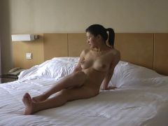 Asian chick poses and fucks for video