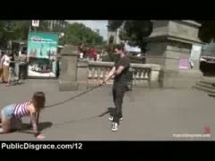 Bound babe made to crawl in public