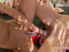 Gorgeous naked lesbos fucking a large double dildo outdoor