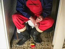 nlboots - red working trousers & rubber boots on toilet