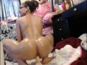 Oiled Babe Rides Large Sex-Toy