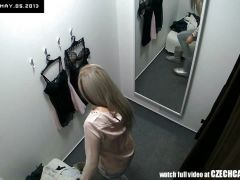 Lovely blonde gets caught changing clothes