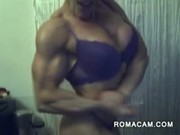 Muscled woman on webcam