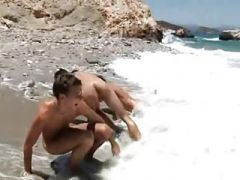 Young men frolicking on the beach