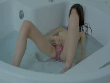 thin girl opening vagina in the bath