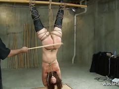 Slave suspended upside down gets caned and spanked
