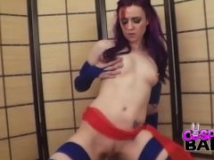 Sexy purple haired girl in a super hot costume