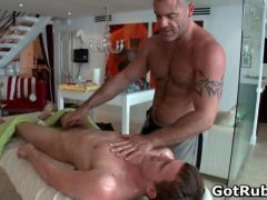 Hunky guy gets oiled up and gay massaged video