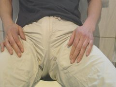 wetting wife\'s white (transparent) capris on loo. Very close