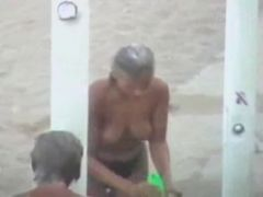 Sexy Topless Babes Take A Shower At The Beach