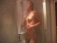 Nude gal washes in shower