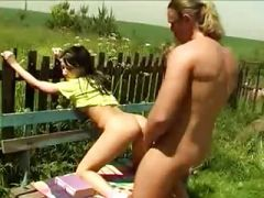 Girl fucking on bench in village