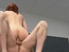 redhead penetrating on the table