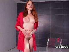 Sexy Amarna Miller pissing in her red rope