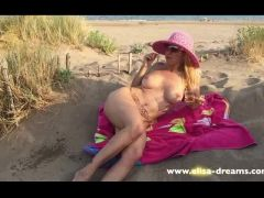 Flashing naked in a wild beach