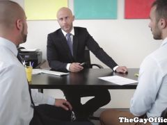 Muscular hunks fucking in office