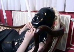 Latex sub gets her mask off
