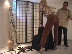 Caned in leather pants