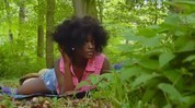 Hot ebony Kissa teases in the woods