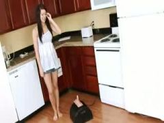 darkhair in the kitchen with huge toy