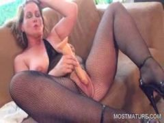 Horny mature pleasuring clitoris