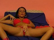 Blackhaired babe gets horny