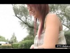 Outdoor stripping and masturbation for amateur redhead