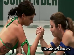 Two babes in bikinis wrestle and fuck