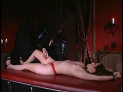 Doxy placed in metal cuffs and spanked