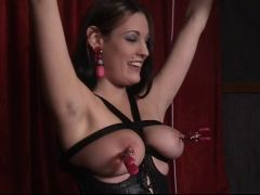 Doxy in leather likes being restrained and having her teats clamped