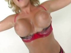 Velicity Von bouncing her huge tits covered in oil