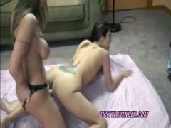 Lesbo Lavender takes a strapon from a busty MILF