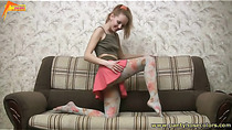 She caresses patterned pantyhose and sucks toes