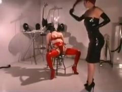 Slave in latex introduced to breath play