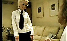 Girl in stockings is spanked by a girl