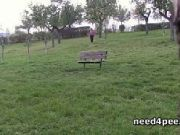Hot brunette pissing on a bench in a park