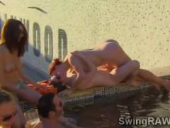 Swinger pool party with everyone fucking in the water