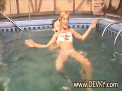 Three naked girls in the pool