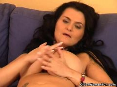 Large boobed older soccer mamma bonks herself with a sextoy