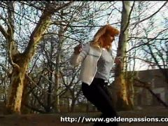 Piss: Mature redhead peeing on the streets with people