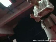 Slave in latex suit beaten in the ring