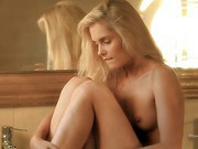 Sasha is a cute blonde haired girl that poses naked
